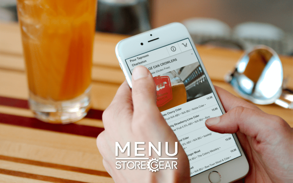 Image of a person's hand holding a smart phone to order beer online using Menu by storegear